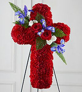 "Vivid Red - Sympathy Cross  Vivid Red - Sympathy Cross - This thoughtful and Bold tribute is a vibrant expression of faith & love. This graceful cross is constructed of bright red carnations, blue iris, roses and other  greenery. Makes a powerful statement at a funeral or graveside burial service. It comes with a metal easel for a floor/ground-standing display. Measures approximately 24""H x 18""W.  Vivid Red - Sympathy Cross - Funeral flowers provide the opportunity to express how much the departed means to you. Celebrate the life of your loved one with one of the beautiful funeral flower arrangements found here such as: Classic Remembrance Urn, Mixed Flowers Sympathy Tribute or one of our Standing Sprays.  →Follow Us On Facebook←"